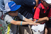 A fan waits to get an autograph from Jordan Spieth during the final round of the AT&T Byron Nelson in Las Colinas, Texas on May 31, 2015. (Cooper Neill for The New York Times)