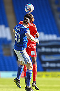 Cardiff City's Ciaron Brown (30) competes for a high ball with Nottingham Forest's Sammy Ameobi (11) during the EFL Sky Bet Championship match between Cardiff City and Nottingham Forest at the Cardiff City Stadium, Cardiff, Wales on 2 April 2021.