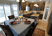 """The kitchen has an L-shaped walk-in pantry behind a frosted glass door (at right in background) that has the word """"Pantry"""" on it. Sheridan and Rikki Glen are At Home in their Tanglewood subdivision home in Caseyville, IL on Wednesday January 16, 2019. <br /> Photo by Tim Vizer"""