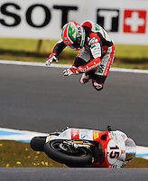Italian 250cc rider Roberto Locatelli had a spectacular crash at the bottom of Lukey Heights on the Phillip Island race track where the Moto GP was held in October 2009.<br /> While trying to keep pace with the bikes ahead, Locatelli found he was going too fast around the corner and over-corrected too much with the brakes.<br /> The bike came to a sudden halt and Locatelli found himself spearing into the air going head over heels. <br /> Although taken away by the medical staff on a stretcher, Locatelli miraculously escaped without serious injury. (Copyright Michael Dodge/Herald Sun)