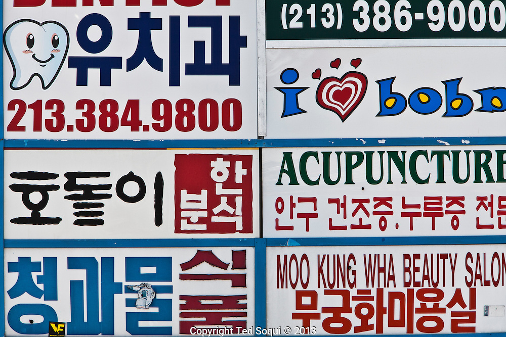Signage on Olympic Blvd.<br /> Koreatown located in the center of Los Angeles populated by 120 thousand residents in a 2.7 mile area. The area is ethnically diverse with 2/3's of the areas residents being born outside the US. It is also the fastest growing area of the city with new banks, restaurants, and housing sprouting up.