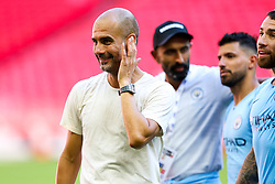 Manchester City manager Pep Guardiola looks on as Manchester City celebrate winning the Community Shield with a 2-0 victory over Chelsea - Rogan/JMP - 05/08/2018 - FOOTBALL - Wembley Stadium - London, England - Chelsea v Manchester City - The FA Community Shield.