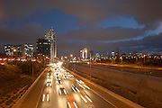 Traffic on the ayalon highway at night, Tel Aviv in the background