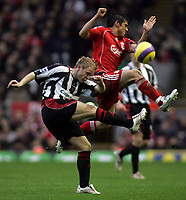 Photo: Paul Thomas.<br /> Liverpool v Sheffield United. The Barclays Premiership. 24/02/2007.<br /> <br /> Derek Geary (L) clears from Mark Gonzalez of Liverpool.