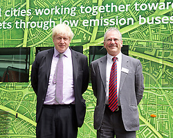 Boris Johnson Mayor of London launches world-first electric double-decker bus trial at global Clean Bus Summit<br /> <br />  <br /> <br /> 29th June 2015<br /> at City Hall, London, Great Britain <br /> <br /> Boris Johnson<br /> Sir Peter Hendy<br /> <br /> <br /> and hybrid double-decker bus wrapped in green livery<br /> <br /> <br /> The Mayor of London Boris Johnson will announce that London is set to trial the world's first purpose-built double-decker purely electric bus, during the first ever global Clean Bus Summit. The Summit is organised with C40, a partnership of global cities acting on climate change, at City Hall. <br /> <br /> <br /> <br /> Photograph by Elliott Franks <br /> Image licensed to Elliott Franks Photography Services