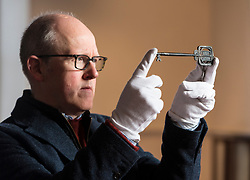 Lyon & Turnbull are auctioning the key used to open the Glasgow School of Art in 1899. The key, which will be sold on April 11, has not been seen in public since the school's opening ceremony.<br /> <br /> Pictured: John Mackie, Specialist at Lyon &Turnbull holding the Glasgow School of Art key, Specialist at Lyon &Turnbull holding the Glasgow School of Art key
