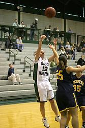 18 December 2004..Amanda Glerum takes a fade away as Angie Carr attempts a block..Illinois Wesleyan University Titans V Webster University Gorlocks.  NCAA Division III Women's Basketball.  Shirk Center, Illinois Wesleyan University, Bloomington IL
