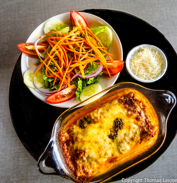Salad with Beef Lasagna and shredded parmesan cheese.