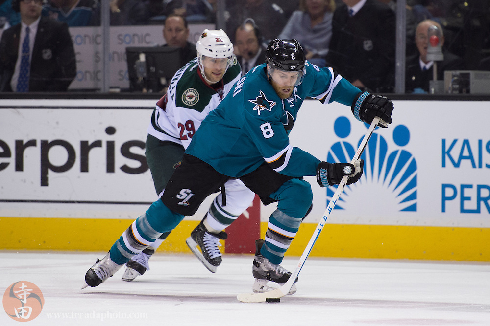 December 12, 2015; San Jose, CA, USA; San Jose Sharks center Joe Pavelski (8) controls the puck against Minnesota Wild right wing Jason Pominville (29) during the second period at SAP Center at San Jose. The Wild defeated the Sharks 2-0.