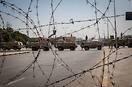 Military personnnel carriers block the street leading to pro-Morsi demonstrators in Cairo.