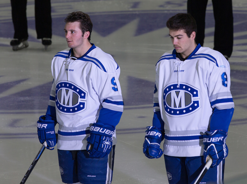 Tyler Lingel, EJ Rauseo, and Devin Albert, of Colby College, in a NCAA Division III hockey game against the Middlebury College on November 16, 2014 in Waterville, ME. (Dustin Satloff/Colby College Athletics)