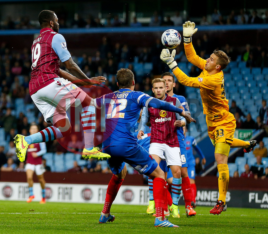 Gary Woods of Leyton Orient makes a save from a header by Darren Bent of Aston Villa - Photo mandatory by-line: Rogan Thomson/JMP - 07966 386802 - 27/08/2014 - SPORT - FOOTBALL - Villa Park, Birmingham - Aston Villa v Leyton Orient - Capital One Cup Round 2.
