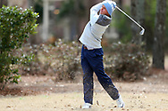 WILMINGTON, NC - MARCH 19: North Carolina's William Register hits an approach on the Marsh Course third hole. The first round of the 2017 Seahawk Intercollegiate Men's Golf Tournament was held on March 19, 2017, at the Country Club of Landover Nicklaus Course in Wilmington, NC.