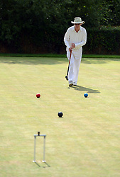 © Licensed to London News Pictures. 14/08/2013. Surbiton, UK David Openshaw, England in action. People participate in the14th World Association Croquet Championship at the Surbiton Croquet Club, Kingston upon Thames on the 14th August 2013. The Final will be played on Sunday 18th August. 80 competitors from 20 countries are taking part. Photo credit : Mike King/LNP