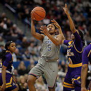 HARTFORD, CONNECTICUT- JANUARY 4: Crystal Dangerfield #5 of the Connecticut Huskies drives to the basket defended by Dominique Claytor #23 of the East Carolina Lady Pirates and Justice Gee #0 of the East Carolina Lady Pirates during the UConn Huskies Vs East Carolina Pirates, NCAA Women's Basketball game on January 4th, 2017 at the XL Center, Hartford, Connecticut. (Photo by Tim Clayton/Corbis via Getty Images)