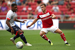 AFC Bournemouth's Jordon Ibe (left) and Bristol City's Joe Bryan (right) battle for the ball during a pre-season friendly match at Ashton Gate, Bristol.