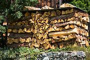 Logpile at typical Swiss wooden chalet in Klosters in Graubunden region, Switzerland