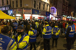 © Licensed to London News Pictures.  24/04/2021. London, UK. Covid Marshals patrol as members of the public make the most of Saturday night out in Soho, central London as lockdown restriction were eased last week. Photo credit: Marcin Nowak/LNP