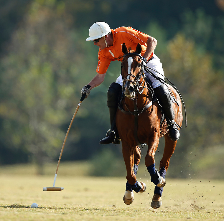 United States Polo Association rider Stephen Felker takes a swing during a polo match at the Atlanta Polo Club on October 18, 2012. © 2012 Shelley Lipton.