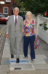 LORD & LADY BAKER OF DORKING at Sir David & Lady Carina Frost's annual summer party held in Carlyle Square, Chelsea, London on 5th July 2006.<br /><br />NON EXCLUSIVE - WORLD RIGHTS