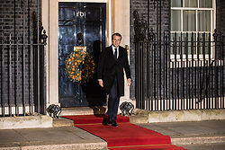 London, UK. 3 December, 2019. French President Emmanuel Macron leaves 10 Downing Street following a meeting with Turkish President Recep Tayyip Erdoğan hosted by Prime Minister Boris Johnson and German Chancellor Angela Merkel to discuss the ongoing dispute between the two Presidents following the Turkish invasion of Kurdish-controlled areas of northern Syria.