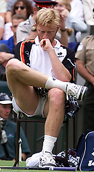 No commercial use. Boris Becker feels the pressure during his match against Patrick Rafter, during the 1999 Wimbledon tennis Championships. Rafter defeated Becker 6-3 6-2 6-3.