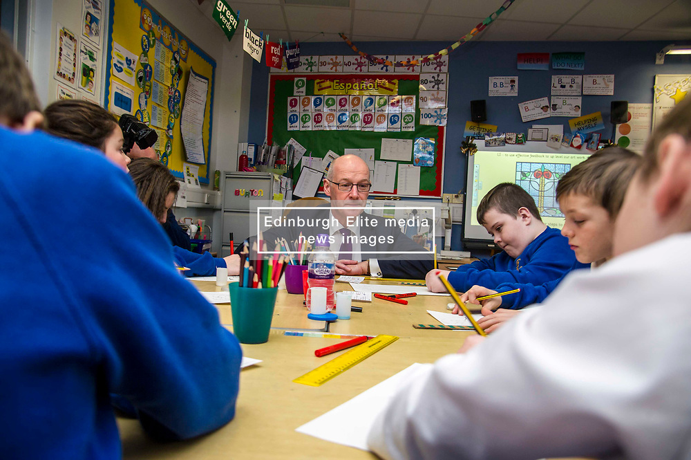 Pictured: John Swinney joined in a primarty six art class<br /> <br /> Today Deputy First Minister John Swinney visited Niddrie Mill Primary School to announce the publication of Scottish school statistics such as teacher numbers, ratios and class sizes. <br /> <br /> <br /> Ger Harley | EEm 12 December 2017