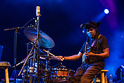 "3 August 2017 – Brooklyn, NY. Singer Nellie McKay opened for Béla Fleck and the Flecktones to a large crowd at the BRIC Celebrate Brooklyn! Festival at the Prospect Park Bandshell. The Flecktones' percussionist Roy ""Future Man"" Wooten on drums and a drumitar, a keyed drum synthesizer shaped like a guitar."