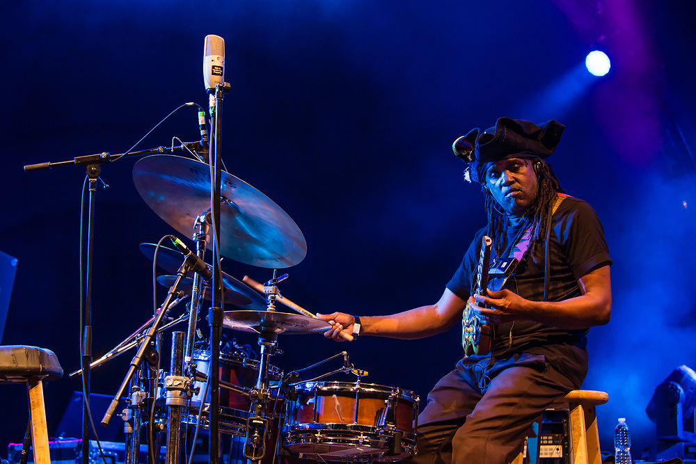 """3 August 2017 – Brooklyn, NY. Singer Nellie McKay opened for Béla Fleck and the Flecktones to a large crowd at the BRIC Celebrate Brooklyn! Festival at the Prospect Park Bandshell. The Flecktones' percussionist Roy """"Future Man"""" Wooten on drums and a drumitar, a keyed drum synthesizer shaped like a guitar."""