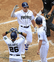 May 29, 2017 - San Diego, CA, USA - San Diego Padres' Hunter Renfroe celebrates with Yangervis Solarte, left, and Wil Myers after hitting a grand slam in the fourth inning against the Chicago Cubs on Monday, May 29, 2017 at Petco Park in San Diego, Calif. (Credit Image: © K.C. Alfred/TNS via ZUMA Wire)
