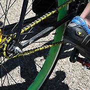 Green bicycle rim and yellow chain seen during chain, Cyclovia Tucson 2011. Bike-tography by Martha Retallick.