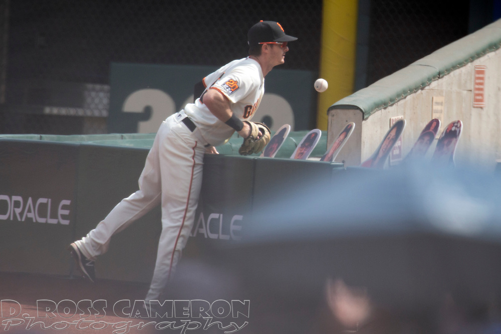 San Francisco Giants right fielder Mike Yastrzemski (5) can't get to a foul ball hit by Seattle Mariners' Dylan Moore during the first inning of a Major League Baseball game, Thursday, Sept. 17, 2020 in San Francisco. This is a makeup of a postponed game from Wednesday in Seattle. (AP Photo/D. Ross Cameron)