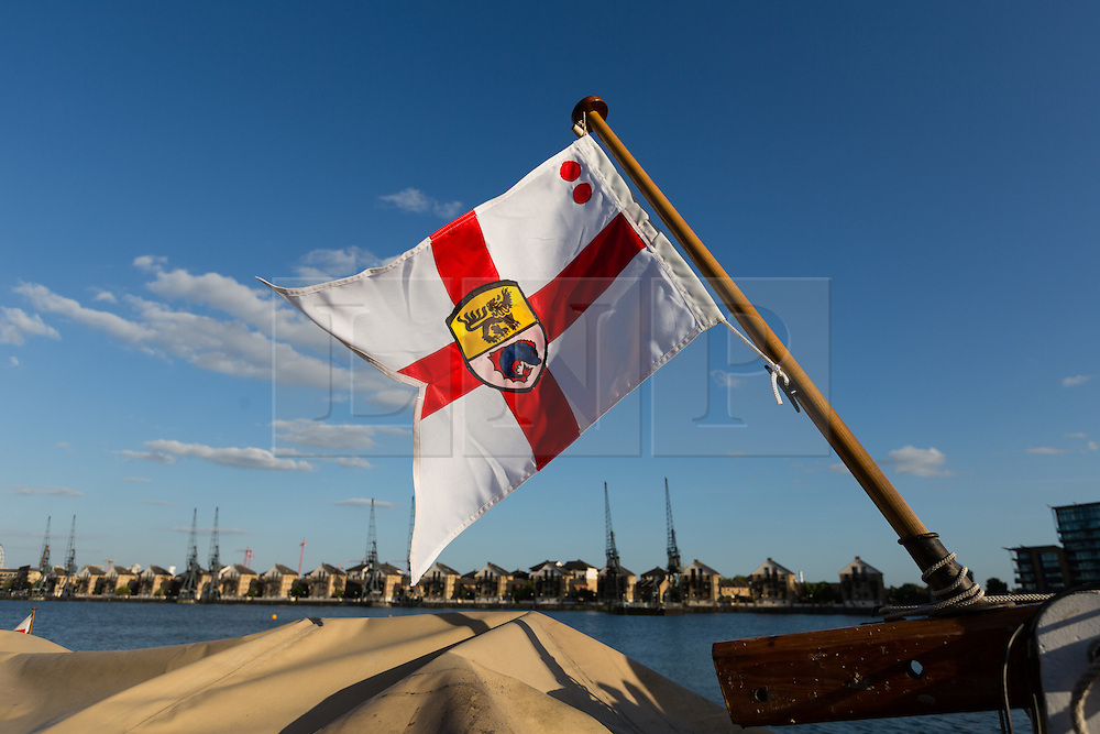 © Licensed to London News Pictures. 16/05/2015. London, UK. The House Flag of the Association of Dunkirk Little Ships blows in the wind from a ship moored in Royal Victoria Dock this evening. Over 20 Dunkirk Little Ships have gathered in London toay before leaving in the morning to continue their journey to Dunkirk to mark the 75th anniversary of the Dunkirk Evacuations. Photo credit : Vickie Flores/LNP