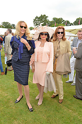 Left to right, JERRY HALL, DAME JOAN COLLINS and STEFANIE POWERS at the Cartier Queen's Cup Polo final at Guard's Polo Club, Smiths Lawn, Windsor Great Park, Egham, Surrey on 14th June 2015