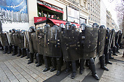 December, 8th, 2018 - Paris, Ile-de-France, France: Riot police on Champs Elysees near Pizza Vesuvio. The French 'Gilets Jaunes' demonstrate a fourth day. Their movement was born against French President Macron's high fuel increases. They have been joined en mass by students and trade unionists unhappy with Macron's policies. Nigel Dickinson