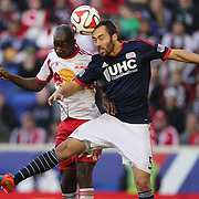 AJ Soares, (right), New England Revolution, wins a header from Bradley Wright-Phillips, New York Red Bulls,  during the New York Red Bulls Vs New England Revolution, MLS Eastern Conference Final, first leg at Red Bull Arena, Harrison, New Jersey. USA. 23rd November 2014. Photo Tim Clayton