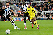 Newcastle United defender Jamaal Lascelles (6) chases Burton Albion striker Marvin Sordell (9) during the EFL Sky Bet Championship match between Newcastle United and Burton Albion at St. James's Park, Newcastle, England on 5 April 2017. Photo by Richard Holmes.