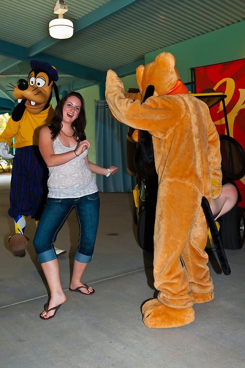 Teenagers with Goofy and Pluto, Fantasia Gardens Pavilion, Walt Disney World, Orlando, Florida USA