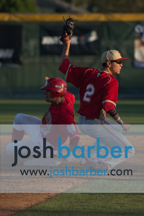 Mater Dei's Brandon Perez (24) sliding while Orange Lutheran's Josh Bissonette (2) tagging out during a Trinity League game at Mater Dei High School on Friday, May 1, 2015 in Santa Ana, Calif. (Photo/Josh Barber)