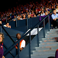 Olympic stewards watch the gold doubles badminton final during the 2012 London Summer Olympics.  China's doubles team of Cai and Fu, the favorites as four-time world champions, defeated Mathias Boe and Carsten Mogensen of Denmark 21-16, 21-15 at the Wembley venue.