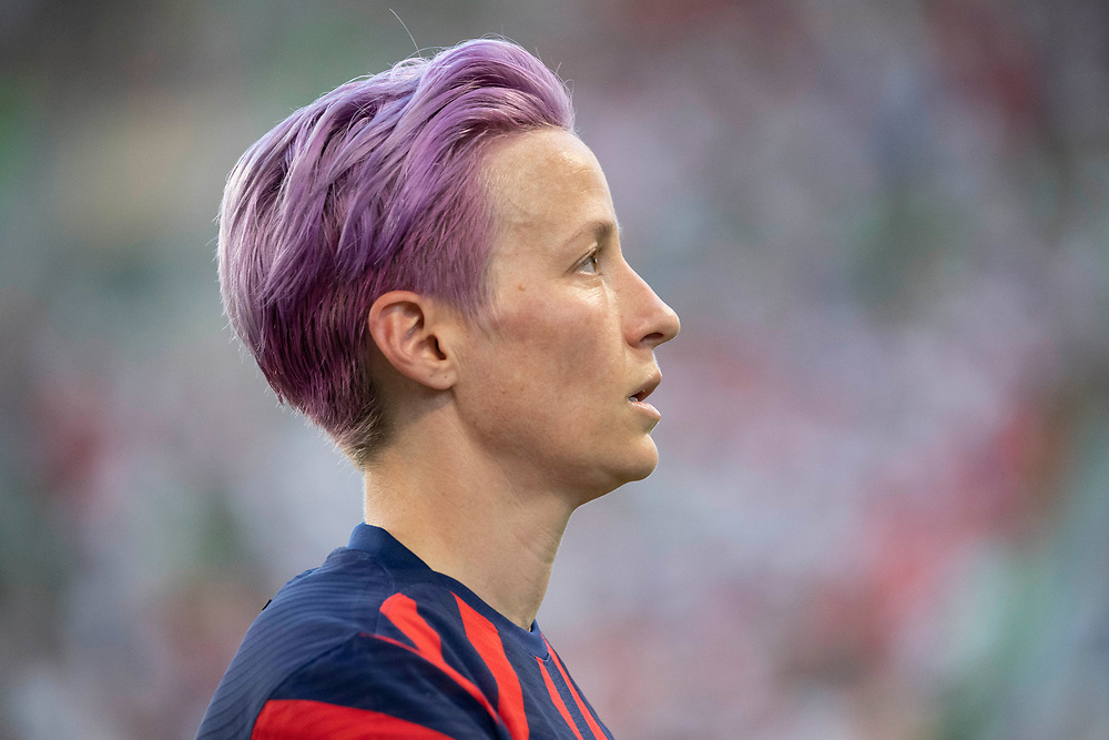 Key forward MEGAN RAPINOE of the USA team walks off the field after taking a  painful fall during the first half of the US Women's National Team (USWNT) victory over Nigeria, 2-0 in the inaugural match of Austin's new Q2 Stadium. The U.S. women's team, an Olympic favorite, is wrapping up a series of summer matches to prep for the Tokyo Games.