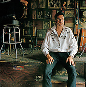 "Johnny Ville pictured here inside the world famous Tootsies bar on  Broadway has come to Nashville to develop his musical career. Nashville  is the Hollywood of Country Music and wannabe stars from all over the world flock there to make their fortune.  Johnny is a natural performer and self promoter ""Elvis was my daddy"" he claims and promises to buy us a Cadillac when he is famous),  Johnny doesn't have a permanent address and seems to rove around trying to make a few bucks with his guitar. It seems the romantic spirit of Nashville is alive and well. Today There is still some great music to be found in Nashville  but one has to navigate some typical US commercialism in the search as  the town cashes in on its reputation."