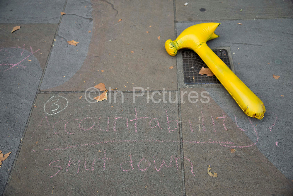 A rubber yellow hammer lays next to chalk graffiti on the pavement which says Accountability Shutdown outside the Cabinet Office in London, United Kingdom on 12th September 2019. Last night the government published details of Operation Yellowhammer which is the codename used by the UK Treasury for cross-government civil contingency planning fin the event of a no-deal Brexit after MPs voted to force its release.