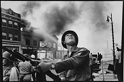 February 2, 2017 - Michigan, U.S. - National Guardsman Gary Ciko of Hamtramck checks on buildings for snipers during the riot on July 23,1967 in Detroit. (Credit Image: © Detroit Free Press via ZUMA Wire)