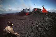 Lava flow on the summit of Mauna Loa, Big Island, Hawaii, watched by geologists. USA.