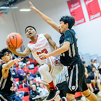 Grants Pirate Frankie Estevan (22) holds off a Capital Jaguar for a field goal during the Eddie Peña Invitational basketball tournament in Grants Thursday.