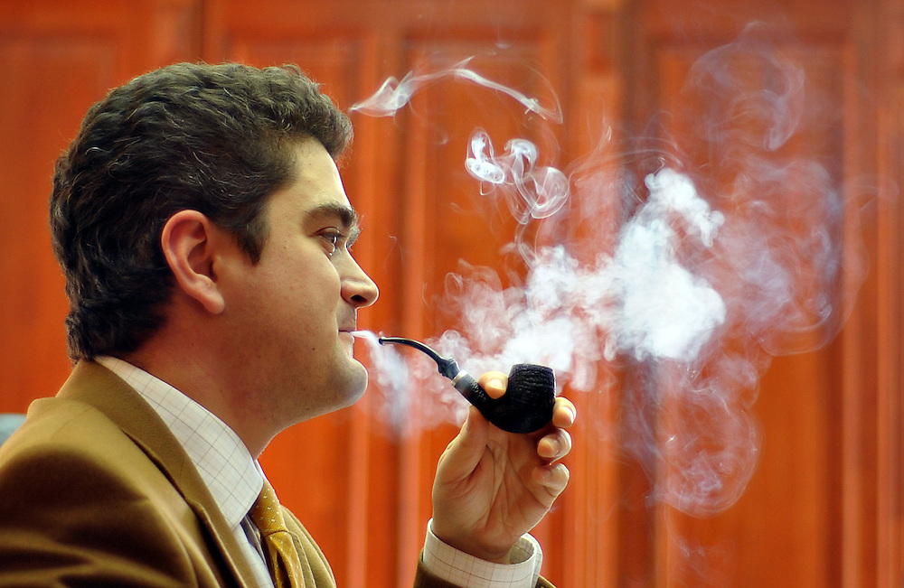 Theodor Paleologu, Minister of Culture, is smoking his pipe during an interveiew for teh news agency Mediafax.