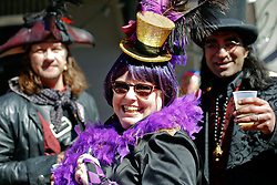 09 February 2016. New Orleans, Louisiana.<br /> Mardi Gras Day. Revelers in bright and colourful costumes fill the French Quarter. <br /> Photo©; Charlie Varley/varleypix.com