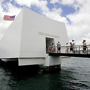 Pearl Harbor, HI, July 18, 2007: The Pearl Harbor Memorial site marks the spot where Japan attacked the U.S. Pacific fleet on December 7, 1941 and drew America into WWII.  Visitors to the site enter the USS Arizona memorial and are told to be aware they are entering a solemn place where many bodies still remain underwater. (Photograph by Todd Bigelow/Aurora)
