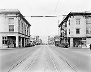 1505-E1. East Burnside, sign is advertising an event on Thursday, March 6, 1930